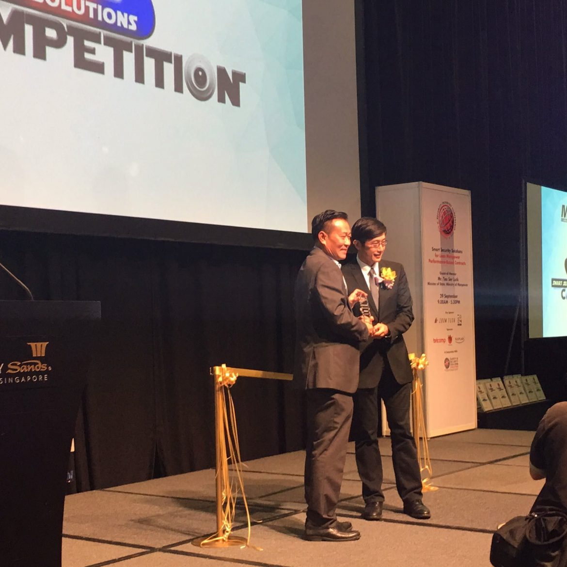 Mr Chow receiving a prize at the Smart Security Solutions Competition 2016